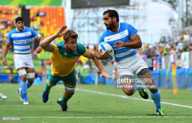 Gaston Revol of Argentina beats Pat McCutcheon of Australia to scores a try during the Men's Rugby Sevens placing match between Argentina and...