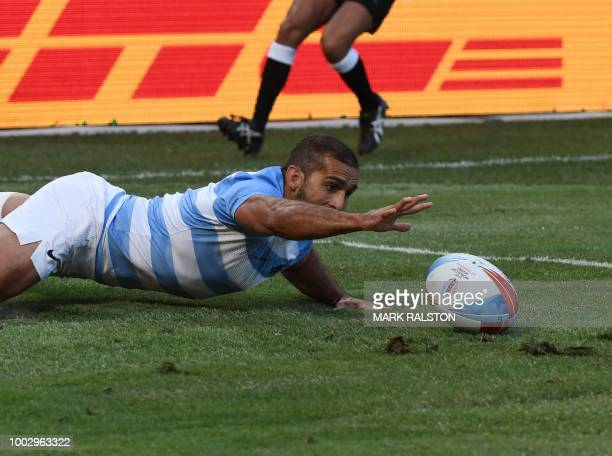 Gaston Revol of Argentina scores a try against Canada during their men's round of 16 game at the Rugby Sevens World Cup in the ATT Park at San...