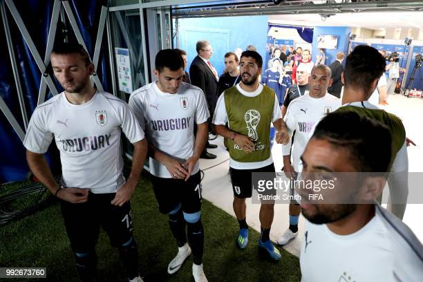 Gaston Silva Maximiliano Gomez Luis Suarez and Maximiliano Pereira of Uruguay wait in the tunnel prior to the 2018 FIFA World Cup Russia Quarter...