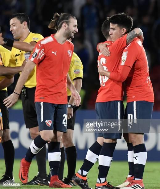 Gaston SilvaFabricio Bustos and Fernando Gaibor of Independiente celebrate after a match between Millonarios and Independiente as part of Copa...