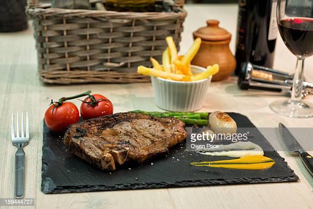 Gastro pub-style steak dinner on a slate plate