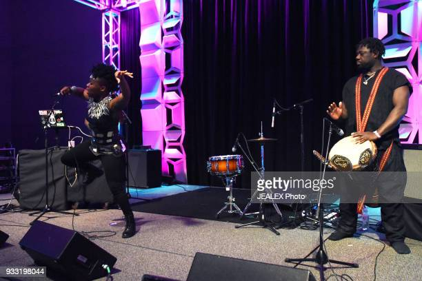 Gata Misteriosa and Assane of Gato Preto perform onstage at International Day Stage during SXSW on March 17 2018 in Austin Texas