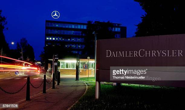 Gate 3 and the administration building of German carmaker DaimlerCrysler are seen at night May 17 2006 in Sindelfingen Germany