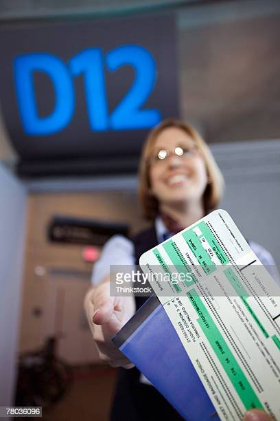 Gate agent taking airline tickets