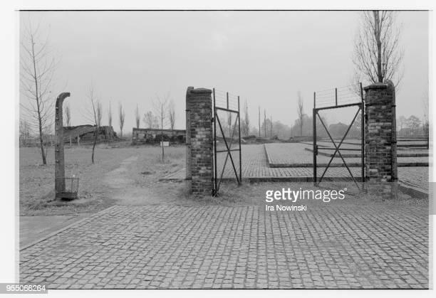 Gate and cobblestone terraces on the site of the crematorium at auschwitz-birkenau Auschwitz-Birkenau, Poland.