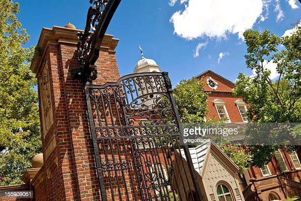 gate and entrance to harvard university campus in cambridge, massachusetts - cambridge massachusetts stock pictures, royalty-free photos & images