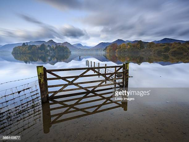 A gate and fence in a flooded field by Derwent Water near Keswick