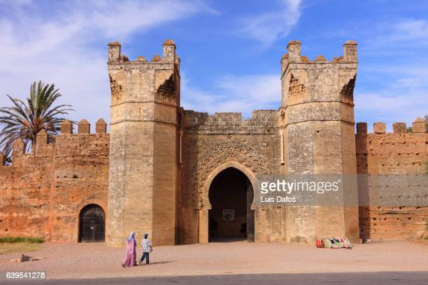 gate and walls of the chellah necropolis in rabat - rabat morocco stock pictures, royalty-free photos & images