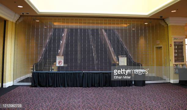 A gate blocks a fan entrance to the Orleans Arena as a result of the cancellation of the Western Athletic Conference basketball tournament on March...