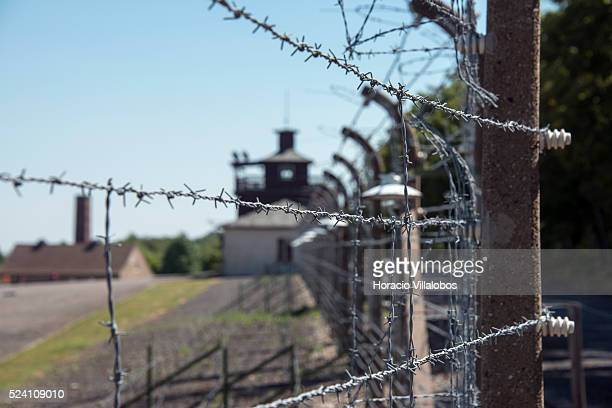 Gate building, crematorium and perimetrical electrified barbed wire in Buchenwald concentration camp near Weimar, Germany, 21 July 2013. The camp,...