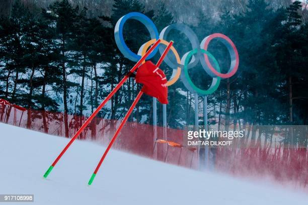 TOPSHOT A gate flag flutters in the wind after the women's giant slalom was postponed due to high winds at the Jeongseon Alpine Center during the...