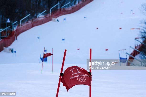 TOPSHOT A gate flag flutters in the wind after the Women's Giant Slalom was cancelled because of strong winds at the Jeongseon Alpine Center during...
