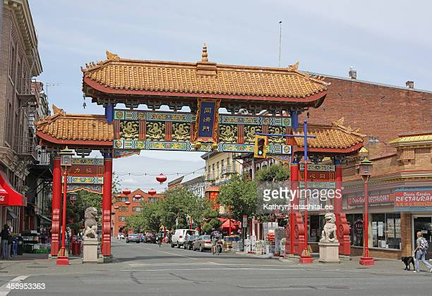 gate in victoria's chinatown, fisgard street, british columbia, canada - chinatown stock pictures, royalty-free photos & images
