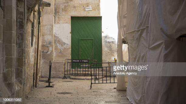 A gate of AlAqsa Mosque is seen closed behind barricades after Israeli forces closed the gate after clashes erupted between Israeli forces and...