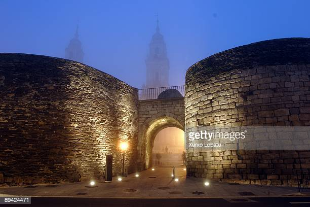 Gate of Santiago in the Roman Wall of Lugo with the Cathedral to the bottom The wall is the most impressive testimony left by the Romans in Galicia A...