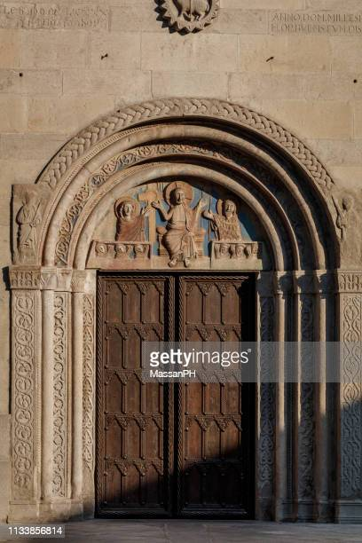 gate of the dome of gemona with its beautiful tympanum just restored - bas relief stock pictures, royalty-free photos & images