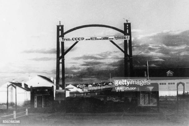 Gate of the Vorkuta coal mine Vorkuta Gulag one of the major Soviet labor camps Russia Komi Republic 1945 The slogan above the entrance reads...