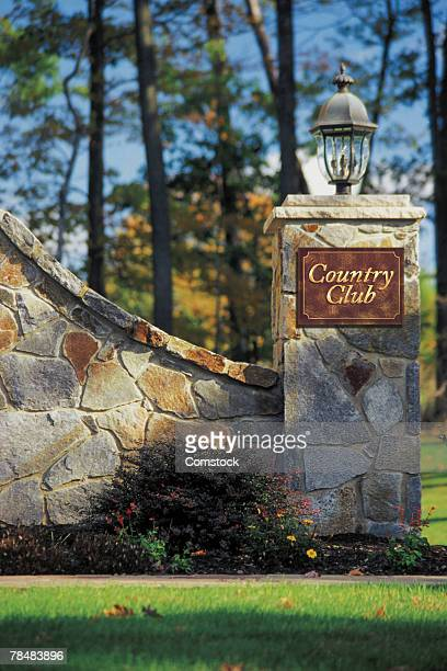 gate to country club - country club stock pictures, royalty-free photos & images