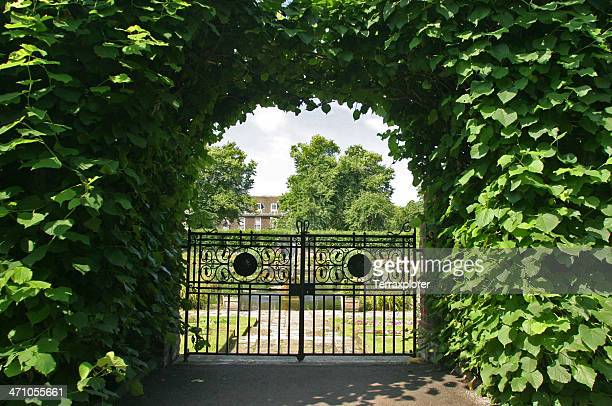 gate to formal gardens - gate stock pictures, royalty-free photos & images