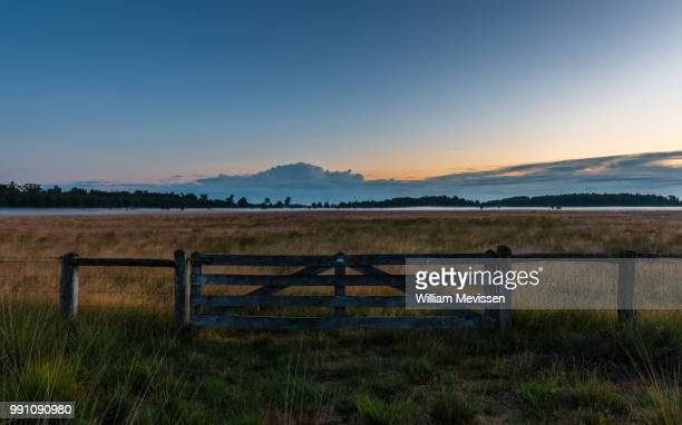 gate to 'the dutch mountains' - william mevissen stock photos and pictures
