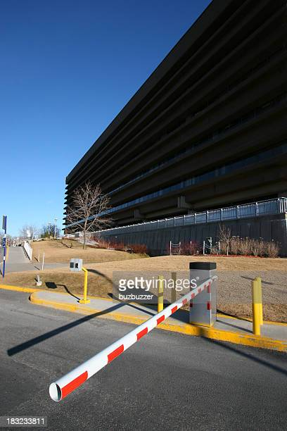 Gated access barrier to an industrial building