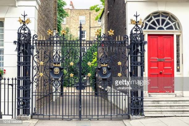 gated entrance to a white stucco townhouse building in holborn london - holborn stock pictures, royalty-free photos & images