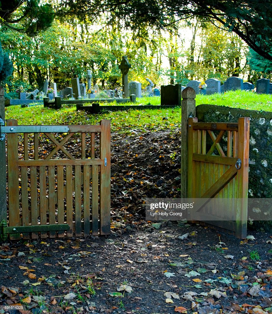 Gated entrance to small cemetery : Stock Photo