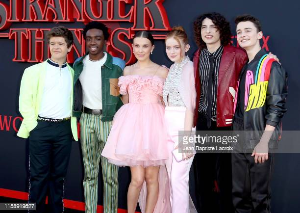 "Gaten Matarazzo, Caleb McLaughlin, Millie Bobby Brown, Sadie Sink, Finn Wolfhard, and Noah Schnapp attend the premiere of Netflix's ""Stranger Things""..."