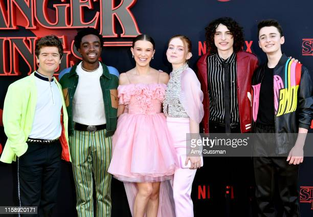"Gaten Matarazzo, Caleb McLaughlin, Millie Bobby Brown, Sadie Sink, Finn Wolfhard, and Noah Schnapp attend the premiere of Netflix's ""Stranger Things""..."