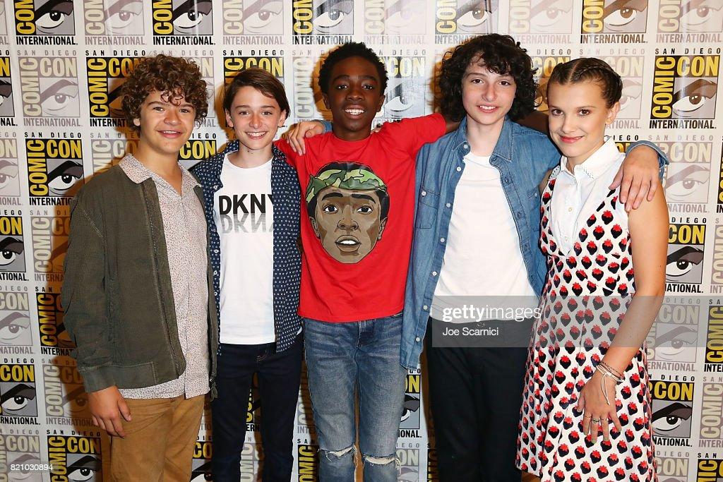 Gaten Matarazzo, Noah Schnapp, Caleb McLaughlin, Finn Wolfhard and Millie Bobby Brown arrive at the 'Stranger Things' press line at Comic-Con International 2017 on July 22, 2017 in San Diego, California.