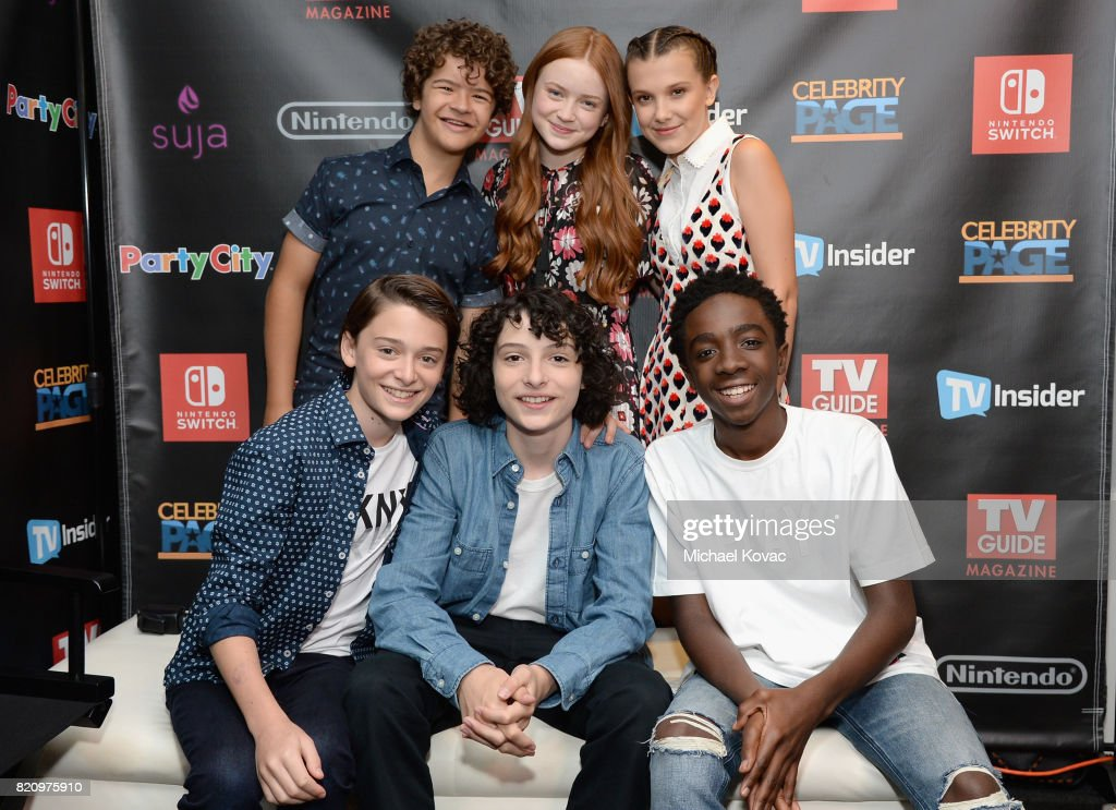 Gaten Matarazzo, Sadie Sink, Millie Bobby Brown, (front-row L-R) Noah Schnapp, Finn Wolfhard, and Caleb McLaughlin from Netflix's 'Stranger Things' stopped by Nintendo at the TV Insider Lounge to check out Nintendo Switch during Comic-Con International at Hard Rock Hotel San Diego on July 22, 2017 in San Diego, California.