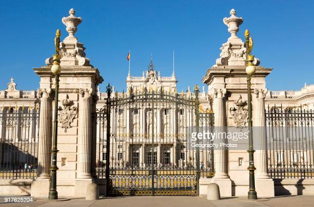 Gates to Plaza de la Armeria, Armory Square, Palacio Real royal palace, Madrid, Spain.