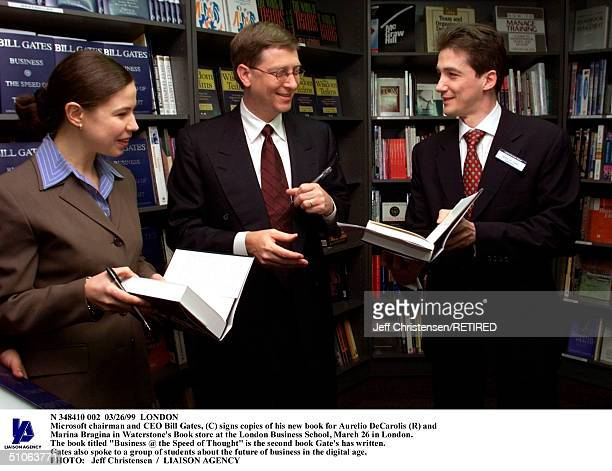 London,26Mar99 - Microsoft Chairman And Ceo Bill Gates, Signs Copies Of His New Book For Aurelio Decarolis And Marina Bragina In Waterstone's Book...