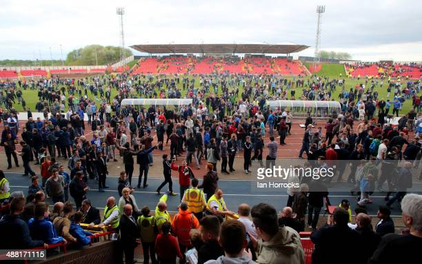 Gateshead fans invade the pitch after the Skrill Conference Premier Play Offs Semi Final second leg match between Gateshead and Grimsby Town at The...