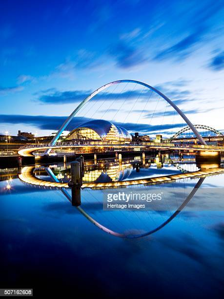 Gateshead Millennium Bridge connecting Gateshead and Newcastle upon Tyne 2008 Floodlit view of the Millennium Bridge at twilight with The Sage and...