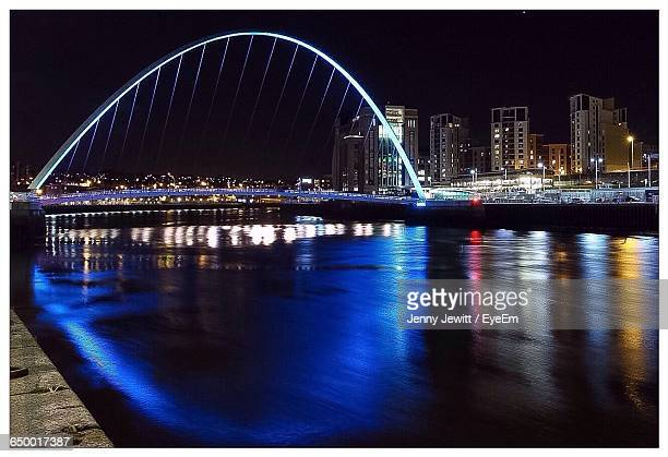 Gateshead Millennium Bridge Over Tyne River At Night