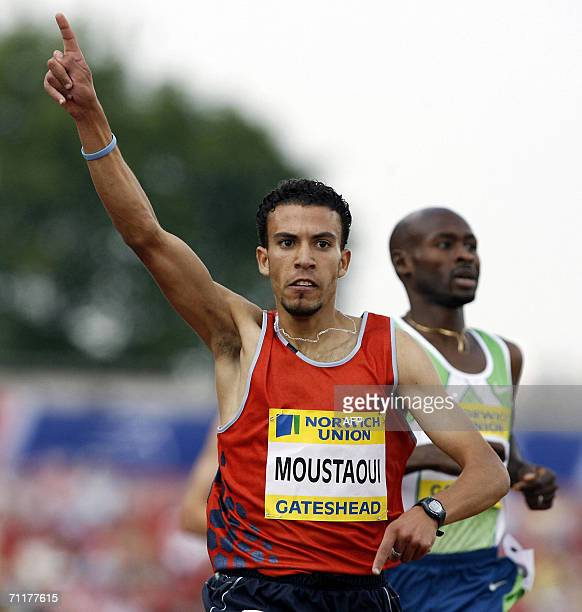 Gateshead, UNITED KINGDOM: Mohammed Moustaoui of Morocco wins the mens 1,500 meters beating Bernard Lagat during the Norwich Union British Grand Prix...