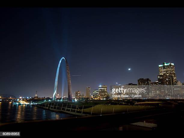 Gateway Arch By Illuminated City Against Sky At Night
