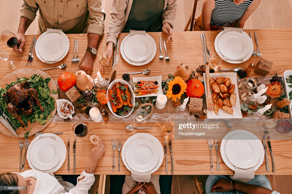 Gather around the table, it's time to give thanks : Stock Photo