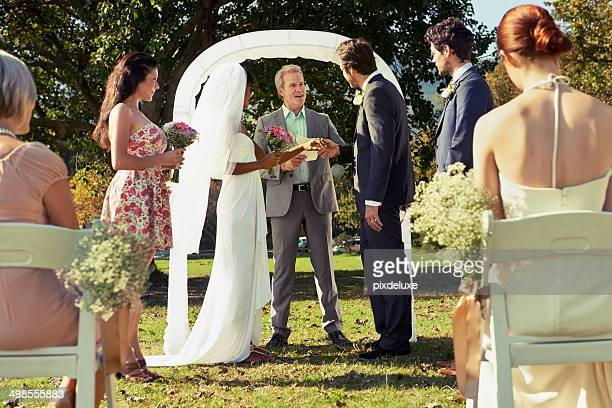 gathered before friends and family - wedding vows stock pictures, royalty-free photos & images