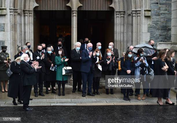 Gathered dignataries lead a round of applause as the funeral takes place of former SDLP leader and Nobel Peace Prize winner John Hume at St Eugene's...