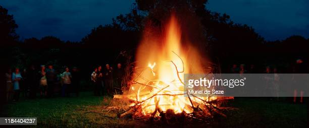 gathering around bonfire. midsummer. - tradition stock pictures, royalty-free photos & images