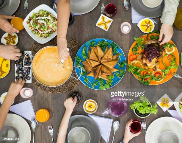 gathering together for family dinner - ramadan stock pictures, royalty-free photos & images