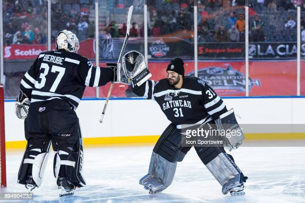 Gatineau Olympiques goalie Mathieu Bellemare taps gloves with Gatineau Olympiques goalie Tristan Berube before Ontario Hockey League Outdoor Game...