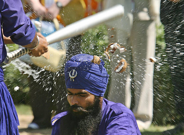 Gatka traditional Sikh martial art players perform in front of Britain`s Prince Charles and his wife Camilla Duchess of York at Anadpur Saheb...