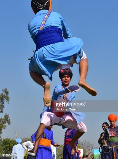 Gatkha participants perform on the 2nd day of the 82nd Kila Raipur Rural Olympics 2018 in the village Kila Raipur on February 3 in Ludhiana India...