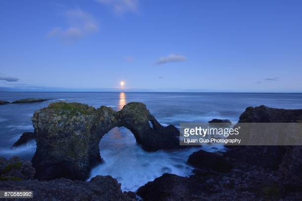 Gatklettur full moonrise, an  Arch Rock in west Iceland