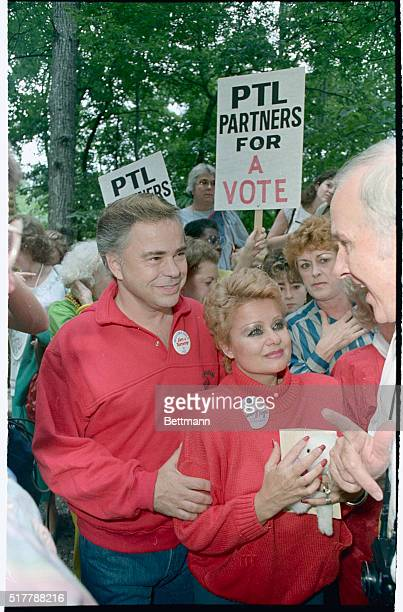Jim and Tammy Bakker listen to the words of supporters during a rally in the driveway of the Bakker's mountain home The Bakkers prayed and talked...