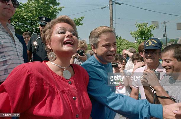 PTL founder Jim Bakker and his wife Tammy Faye are greeted by wellwishers after they attended a scroll signing June 30 to commemorate the...