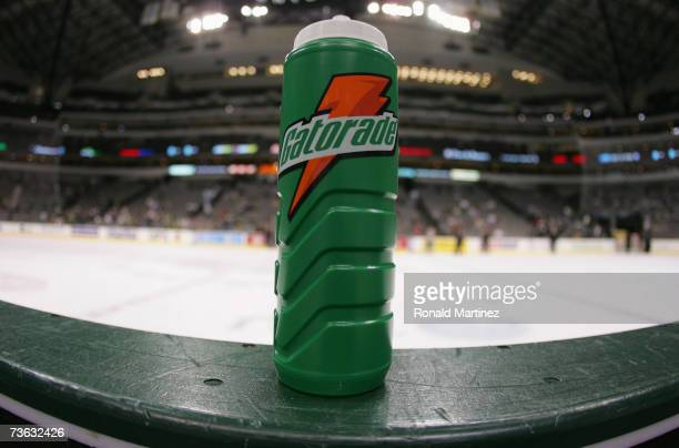 Gatorade water bottle sits on the boards at the bench during the NHL game between the Columbus Blue Jackets and the Dallas Stars during their NHL...